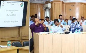 Sign Language Expert interacting with ECI officials while they practise fingerspelling alphabets