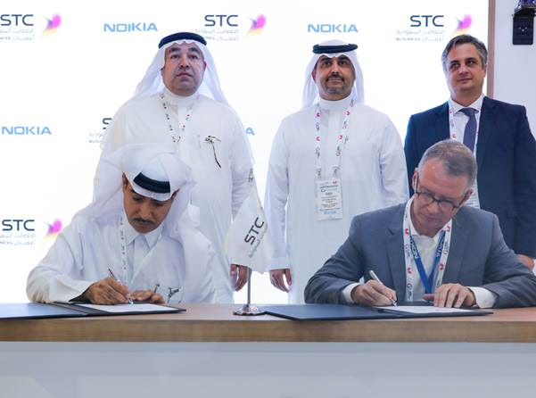 (Left to right) Dr. Fahad Mushayt, CEO, STC Specialized; and Amr K. El Leithy, Head of the MEA market, Nokia, sign MoU. In the background (left to right) Dr. Tarig Enaya, Senior VP of Enterprise Business Unit at STC; Waseem Al-Marzogi, Head of the STC customer business team at Nokia; and Bernard Najm, Head of the Middle East Market Unit, Nokia.