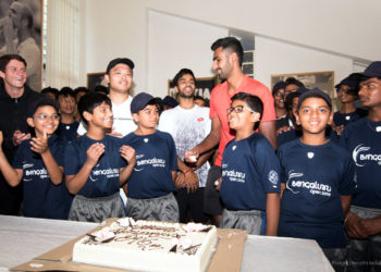 Ball boys cutting a cake to mark the children's day. ATP professionals Sumit and Prajnesh can be seen sharing the joy. Pic credit: Deepthi Indukuri