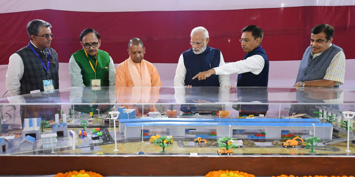 The Prime Minister, Narendra Modi at the dedication of the India's First Multi-Modal Terminal on river Ganga to the Nation, in Varanasi, Uttar Pradesh on November 12, 2018. The Union Minister for Road Transport & Highways, Shipping and Water Resources, River Development & Ganga Rejuvenation, Nitin Gadkari, the Chief Minister of Uttar Pradesh, Yogi Adityanath and the Secretary, Ministry of Shipping, Gopal Krishna are also seen.