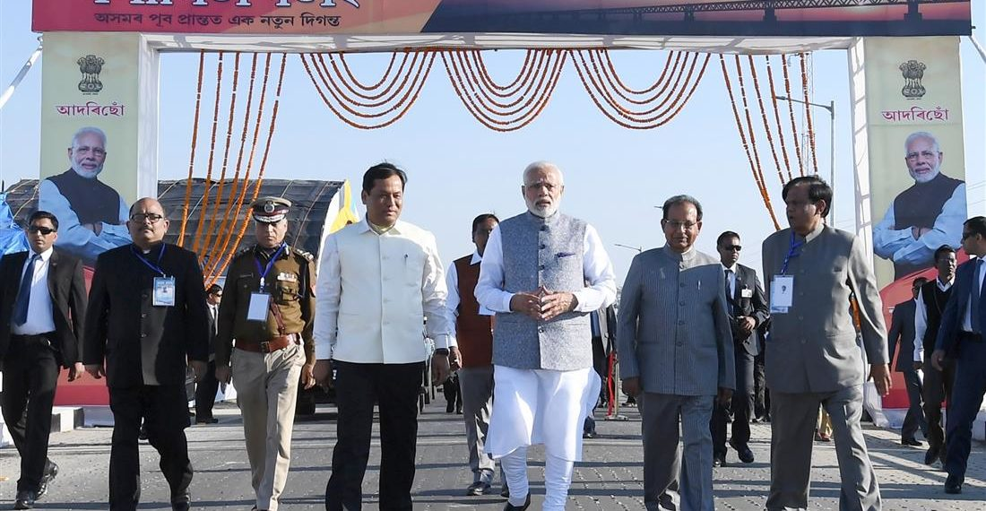 The Prime Minister, Narendra Modi at the dedication of the India's longest Bogibeel Bridge to the nation, at Dibrugarh, Assam on December 25, 2018. The Governor of Assam, Jagdish Mukhi and the Chief Minister of Assam, Sarbananda Sonowal are also seen.