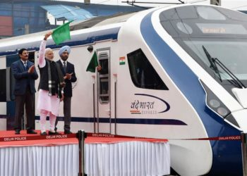 """The Prime Minister, Narendra Modi flagging off the first Semi High Speed Train """"Vande Bharat Express"""", at New Delhi Railway Station on February 15, 2019."""