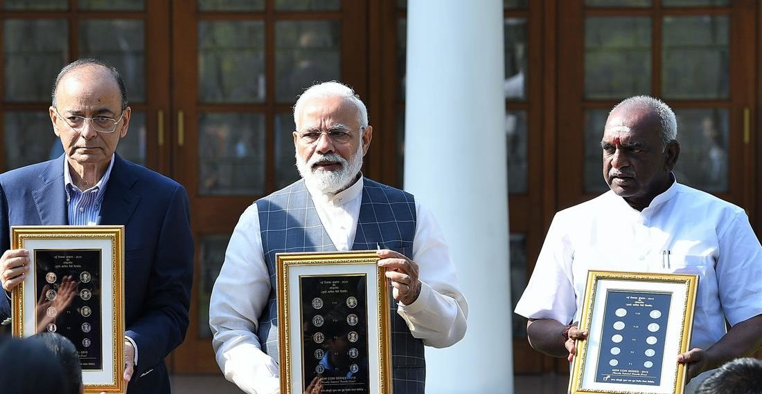 The Prime Minister, Narendra Modi releasing the new series of visually impaired friendly circulation coins, at a function, at 7 Lok Kalyan Marg, New Delhi on March 07, 2019. The Union Minister for Finance and Corporate Affairs, Arun Jaitley and the Minister of State for Finance and Shipping, P. Radhakrishnan are also seen.